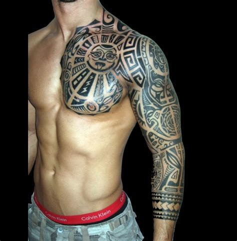tribal tattoo on chest and shoulder pok caer arm galleries
