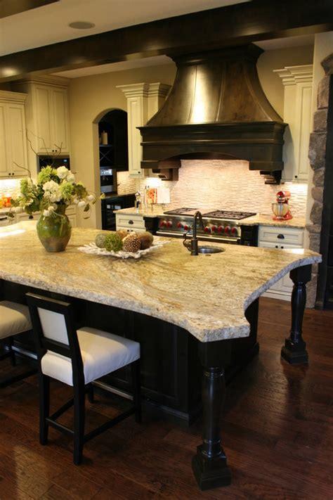 the kitchen island serves many purposes design indulgences the kitchen island serves many purposes design indulgences