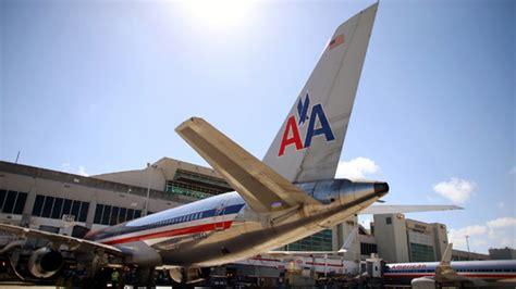 american airlines flight airline passenger opens door jumps onto tarmac