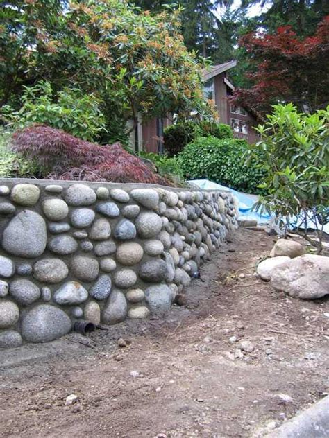 Rock Retaining Wall What Is The Proper Procedure To Build A Rock Wall The