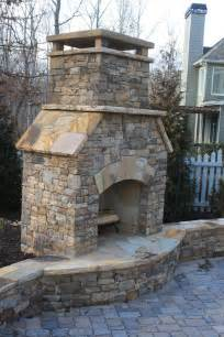 outdoor stacked fireplace with hearth and seating