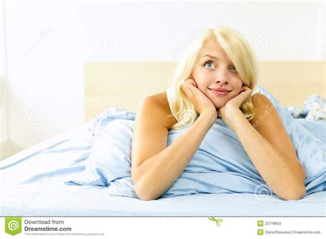 laying in bed pretty woman laying in bed daydreaming stock photos image 23718653