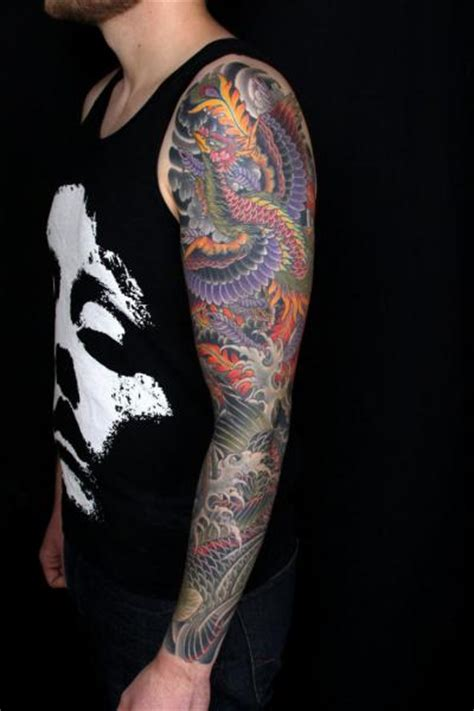 japanese phoenix sleeve tattoo by kings avenue
