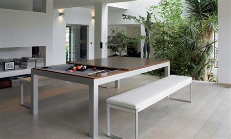 kitchen pool table this dining table hides a pool table underneath