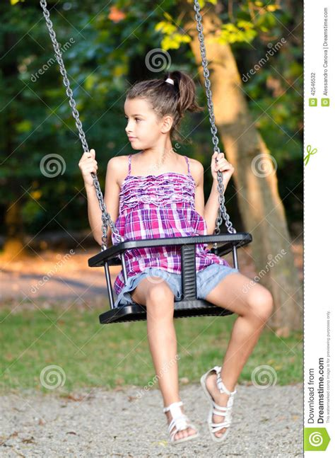 little girl on swing little girl playing on the swing stock photo image 42546532