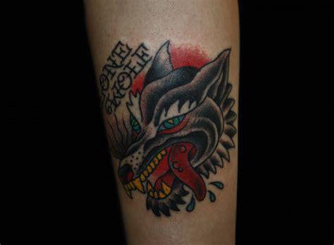 old school wolf tattoo arm school wolf by inkrat