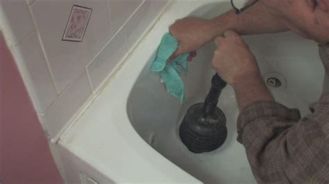 what to use to unclog a bathtub video how to clear a clogged sink or tub ehow