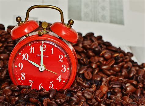 coffee wallpaper red red and white analog alarm clock and black coffee bean lot