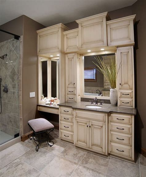 bathroom vanity with built in cabinets around mirrors