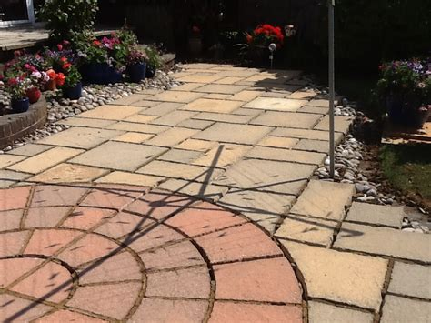 Cleaning Concrete Patio Slabs by Stained And Damaged Sandstone Patio Restoration In Rushden