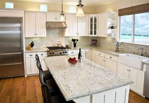 Kitchen with white cabinets and colonial cream granite worktops