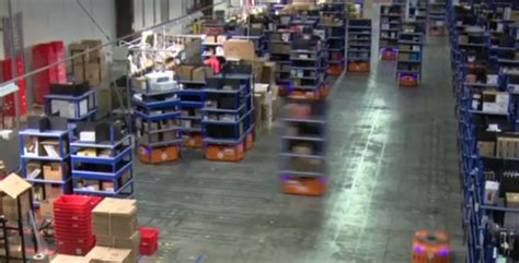 amazon warehouse robots amazon uses an army of robot workers in its warehouse to
