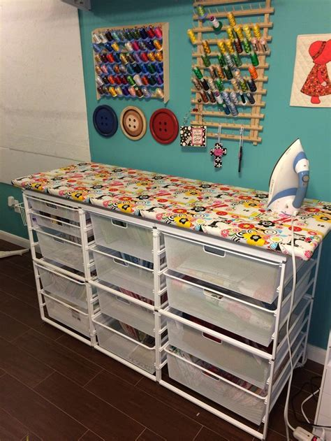 sewing room storage quilting ironing station with lots of fabric storage sewing fabric storage