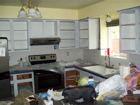 painting your kitchen cabinets running with scissors how to paint your kitchen cabinets