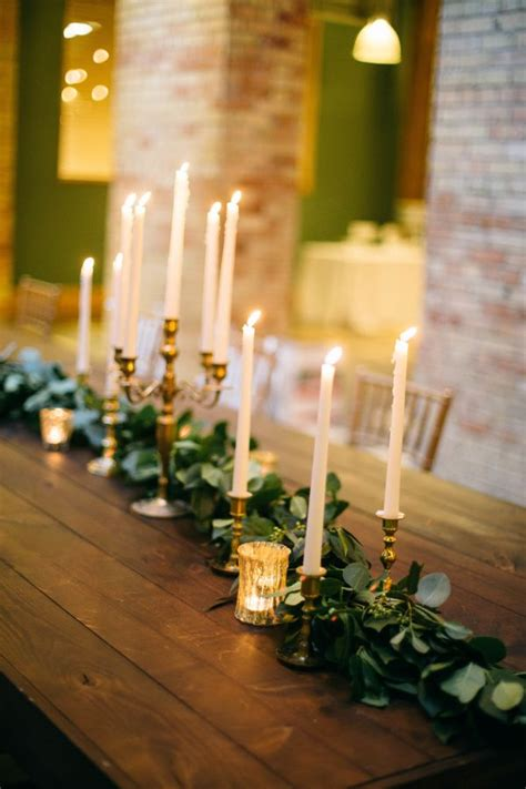 Wedding Aisle With Tables by Taper Candle And Greenery Centerpiece Mercury Glass