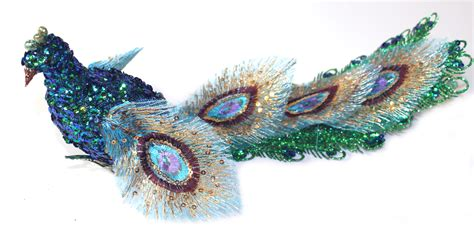 proud as a peacock teal beauty feathered bird clip on
