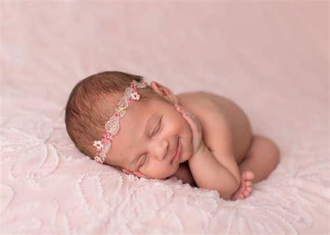 heartwarming portraits of newborn babies smiling sweetly