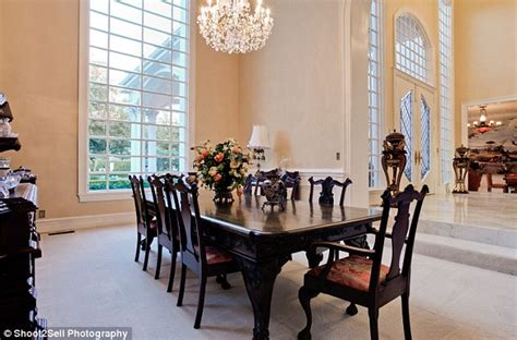 Foyer Open To Dining Room by Pastel Pink Mansion Once Owned By Goes Up For