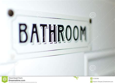 bathroom writing bathroom sign on white door label stock image image of
