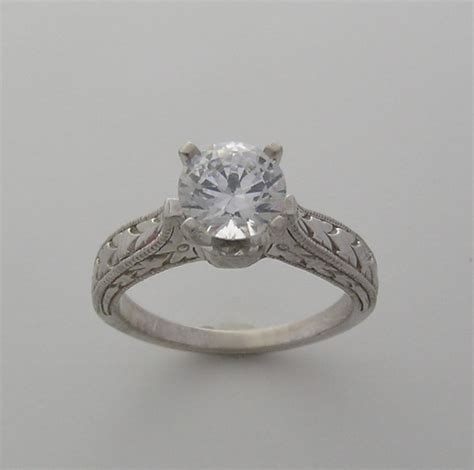 traditional unique engraved engagement ring setting
