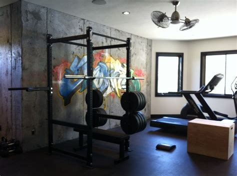 large fans for gyms basement w cement walls graffiti mat floor and