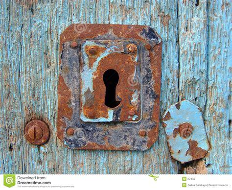 blue door  keyhole royalty  stock photo image