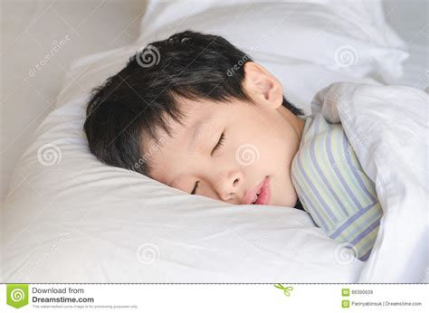 sleeping in asia boy sleeping on bed stock photo image 66390639