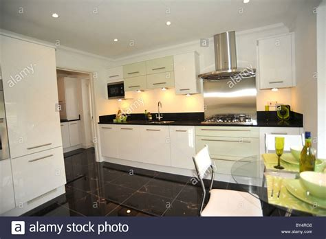 modern show home kitchen  black granite worktops stock photo  alamy