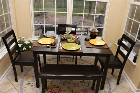 bench table and chairs for kitchen round oriental rug beneath small rectangle black kitchen table with leather bench and