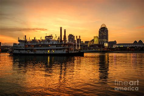 boat tours cincinnati cincinnati skyline and riverboat at sunset photograph by