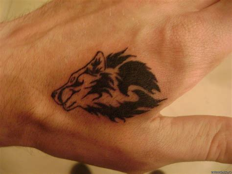 small black wolf on the hand tattoo wolf tattoos