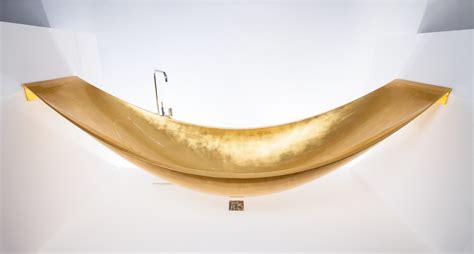 gold vessel hammock bath tub  soak   lap  luxury pursuitist