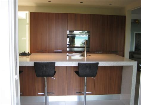 modern walnut kitchen cabinets modern kitchen white countertops walnut cabinets