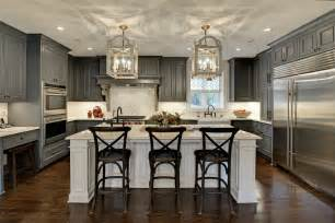 Black oak cabinets all over the kitchen with white polished dining