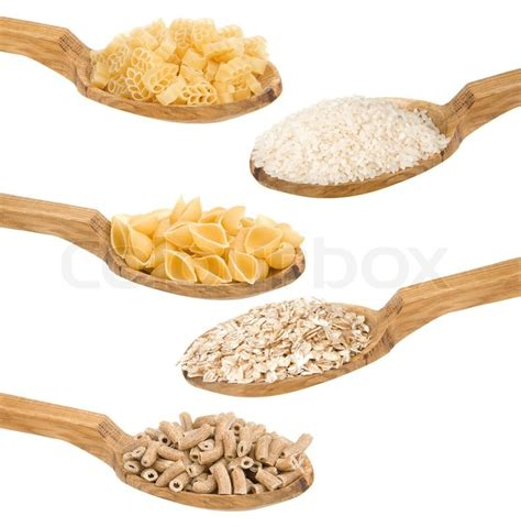 Wooden Rice Spoon pasta and rice in wooden spoon isolated stock photo