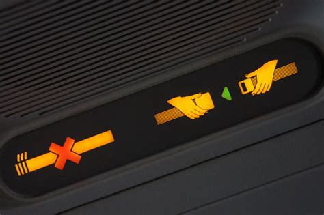 no smoking signs on airplanes man taken off plane by police after opening emergency exit
