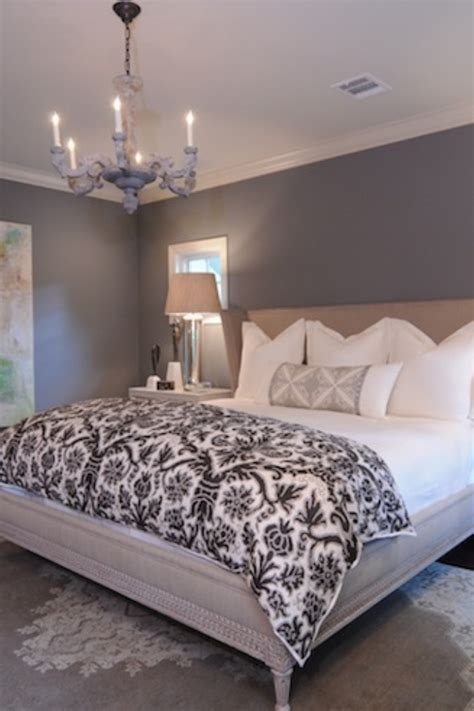 grey paint on the walls white bedding clean and simple feel to this bedroom for the home