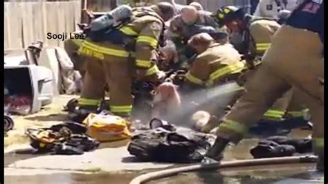 anaheim firefighter falls through roof california firefighter falls through burning garage roof