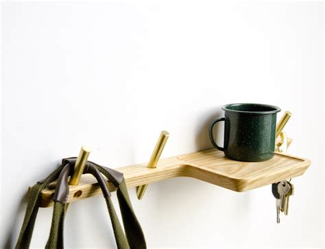 Wall Valet Hooks Intersect Valet A Series Of Wall Hooks And Wall Shelf