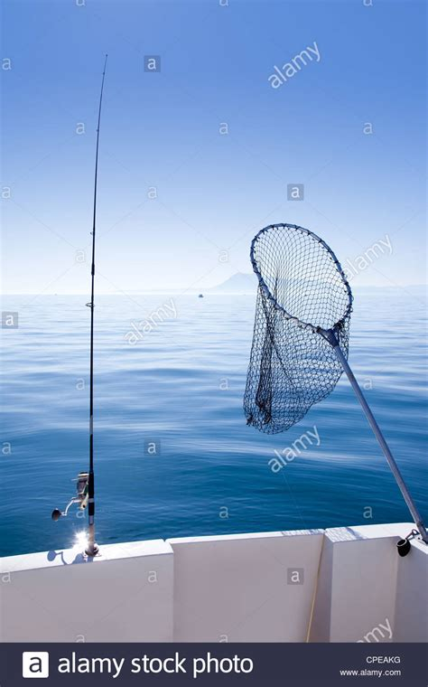 boat landing pole boat fishing rod and landing net in mediterranean blue sea