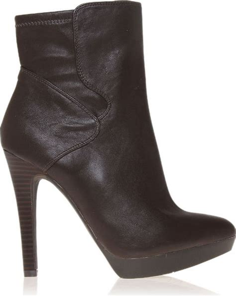 nine west izzabel leather ankle boots in brown lyst