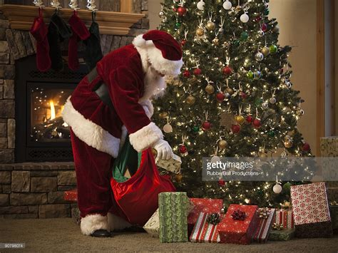 santa claus and the trees santa claus putting presents the tree stock photo