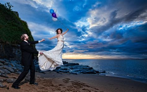 Bride with balloons floating away from the groom