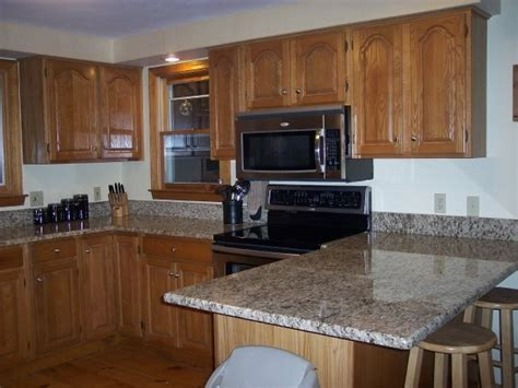 oak kitchen cabinet makeover picture of 13 oak kitchen cabinets refinishing proper for