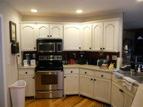 white or brown kitchen cabinets antique white cabinets with brown glaze vintage chic
