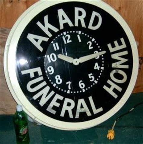 neon clocks advertising funeral homes