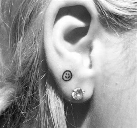 rita ora s tattoo behind ear rita ora shows off new smiley face earlobe tattoo