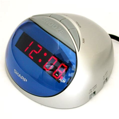 sharp spc002 hi lo alarm clock with battery backup snooze and silver blue