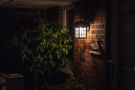 house porch at night porch light safety leave it on or turn it off safewise