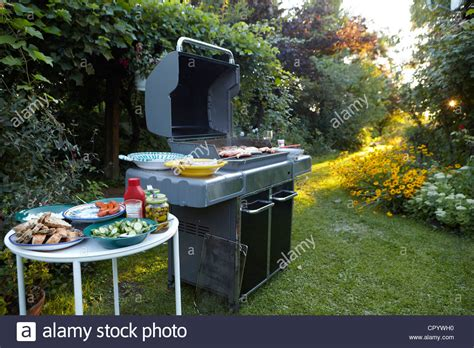 bbq area with large barbecue salads and side dishes in